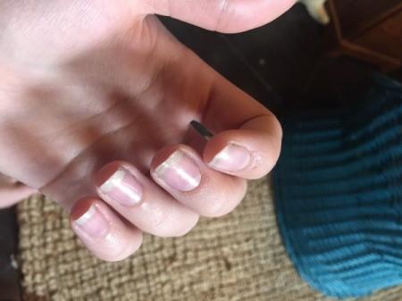 Fingernails with a natural manicure.