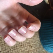 Fingernails with a natural manicure.
