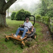 Man on Riding Lawn Mower