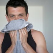 Man Smelling Polyurethane Odor on Shirt