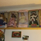 Value of Porcelain Dolls - boxed dolls on a shelf