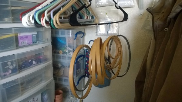 Use Hangers to Store Embroidery Hoops - hoops hung on a hanger with paper clips
