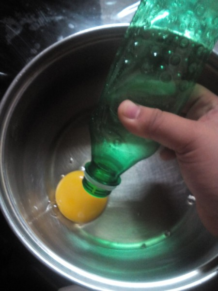 Separating an egg yolk, using a plastic bottle.