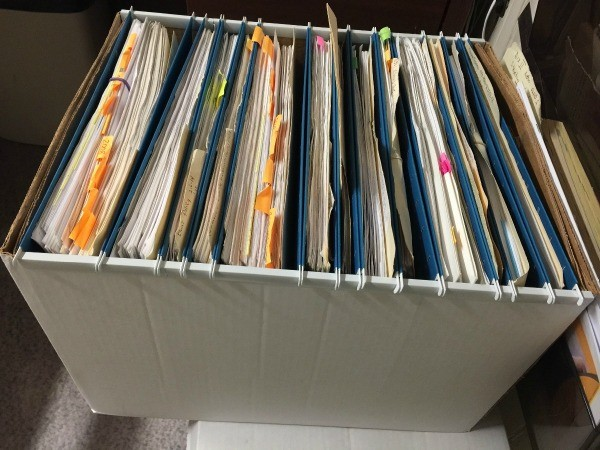 An organized box with hanging file folders.