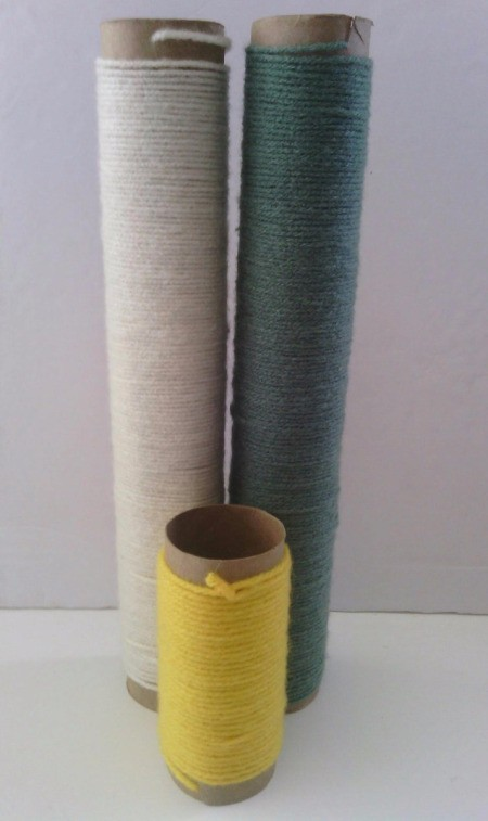Paper Towel Rolls as Yarn  Organizer - yarn wrapped around paper tubes