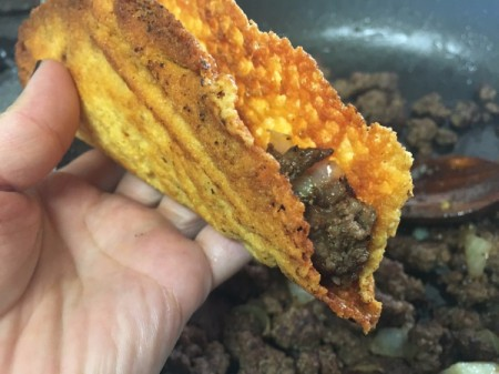 burger in cheese taco shell