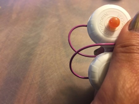 Contact Lens Case as Earbud Headphones Case - gently wrap wire between bowls