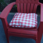 Thrifty Patio Chair Pillows - checkerboard cushion on red plastic patio chair