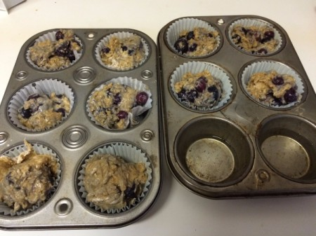 filled blueberry muffin tins ready to bake