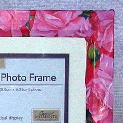 A decorative picture frame made with wrapping paper.