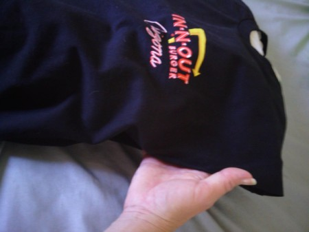 A black T-shirt from In-N-Out Burger with a pillow tucked inside.
