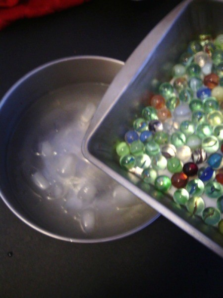 How to Make Crystallized Marbles - slowly pour marbles into the bowl of cold water