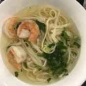 Korean-Style Noodle Soup with Chicken and Shrimp in bowl