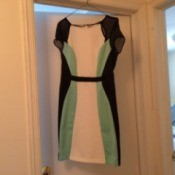 A dress on a hanger in a doorway.