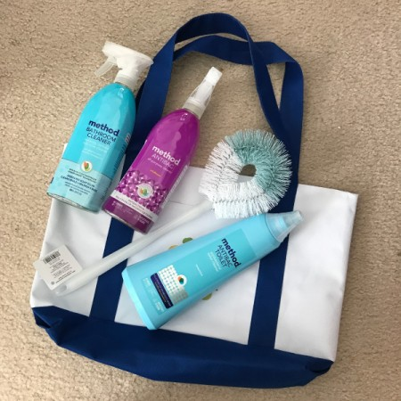 A tote and several personal care and cleaning items from the store.