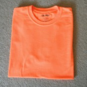 A perfectly folded orange T-shirt.