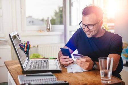 Man Reviewing his Credit Card Rewards