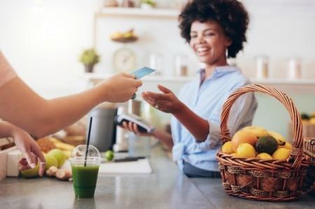 Woman using Credit Card at store