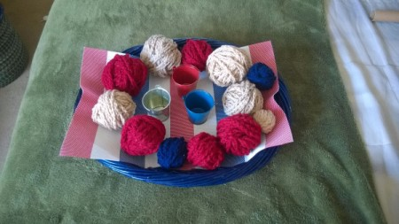 Crocheted Americana Centerpiece - make crochet chains with the yarn and wrap it around the balls, secure beginning and end with pins