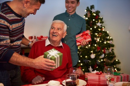 Christmas GiftS Being given to Elderly Dad