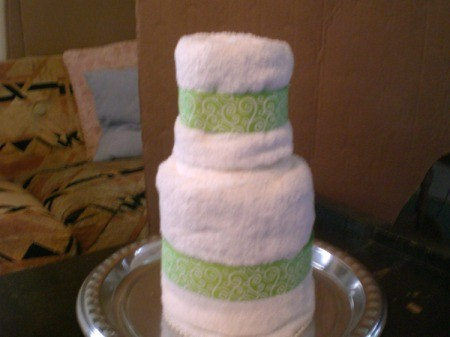 Bridal Shower Centerpiece or Gift - stack towels and slip bottle down in the center