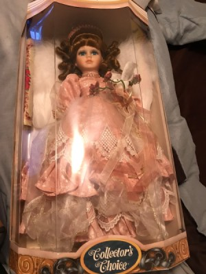 Value of Porcelain Doll - doll wearing pink dress in box