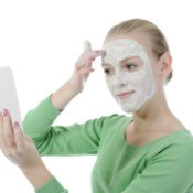 Woman Applying Aspirin Face Mask