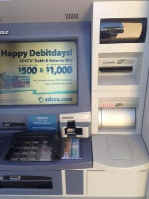 Count Cash Before Inserting into ATM - photo of an ATM
