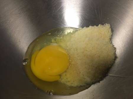 egg and Parmesan in bowl
