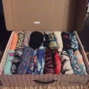 Store Leggings in a Shoe Box - rolled leggings stored in a large shoe box
