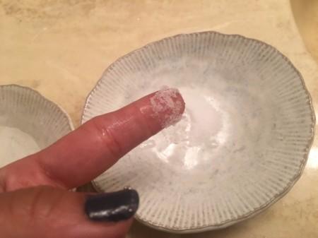 Salt for Removing Super Glue from Fingers - damp salt on fingertip
