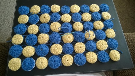 Crocheted Yo Yo Place Mat - finished checkerboard pattern from right side with rows tied together