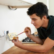 Electrician Installing Power Outlet