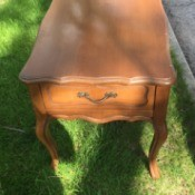 Value of Mersman Side Table - sitting in grass