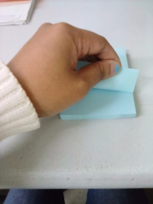 A sticky note being pulled from left to right.