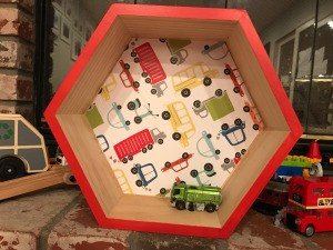 Honeycomb Hexagon Personalized Shelf - truck motif shelf with a toy inside