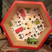 Honeycomb Hexagon Personalized Shelf - truck motif shelf with a toy inside