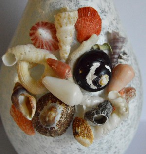 Sea Fever Recycled Bottle Vase - hot glue the shells and pieces of coral to the bottle and spray with  clear finish and allow to dry
