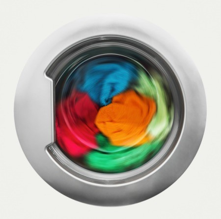 Colorful clothing in a washing machine.