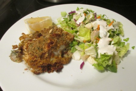Creamy Caesar Herb Crusted Haddock on plate with salad