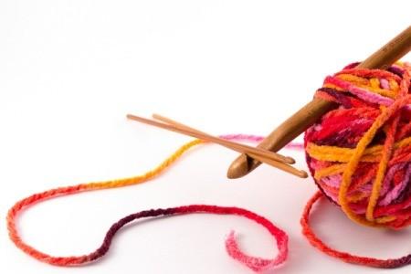 Crochet hooks and a ball of yarn.