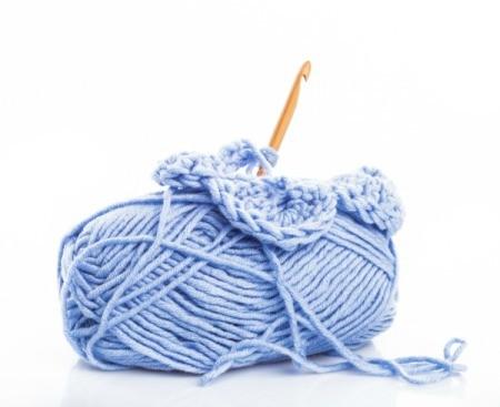 A skien on yarn and a crochet hook.