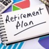A calculator and notebook that says retirement plan.