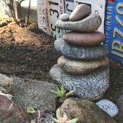 Stacked Rocks in the Garden - stack of rocks in a garden