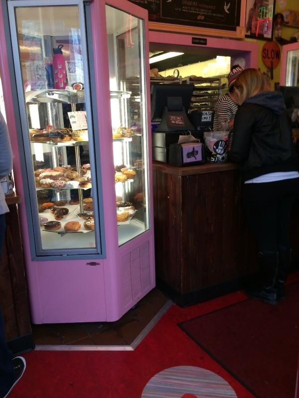 Visting Voodoo Doughnuts (Portland, OR) - rotating pink display cases