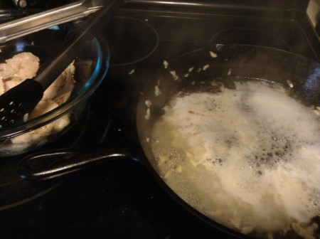 Adding champagne to deglaze pan.