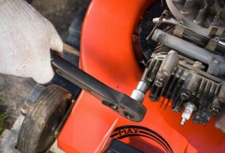Repairing a lawn mower.