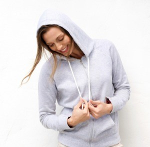 A woman wearing a soft gray sweatshirt.