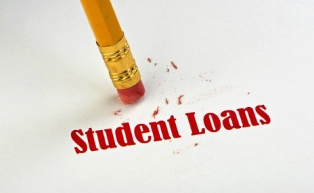 A picture of a pencil eraser and a piece of paper that says Student Loans on it.