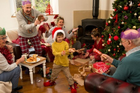 A large family exchanging Christmas gifts.